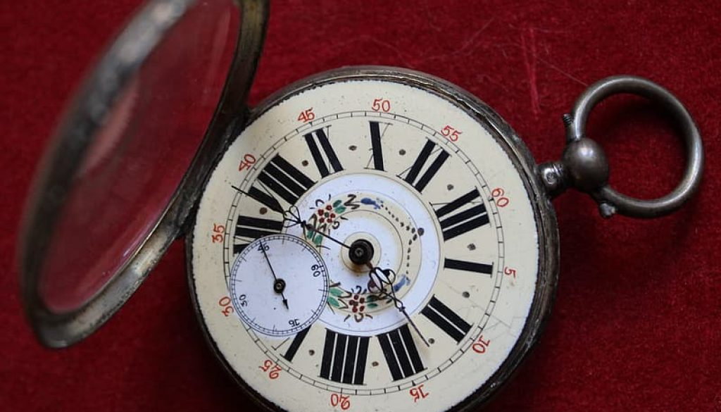 silver-and-white-round-analog-pocket-watch
